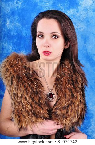 young girl with a pendant dressed in a fur coat