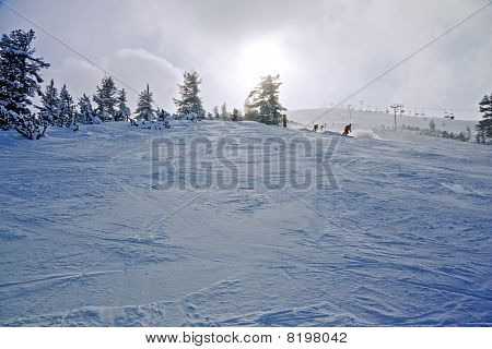 Skiers On The Slope At Winter Resort