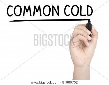 Hand With Pen Writing Common Cold On Whiteboard