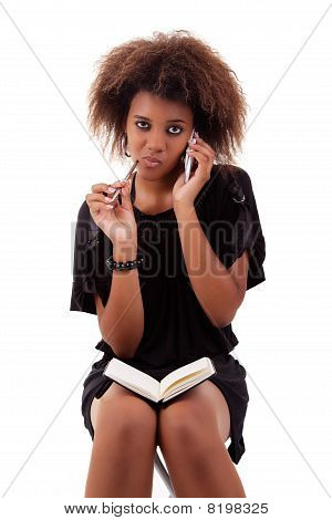 Beautiful Black Woman On The Phone Taking Notes, Isolated On White Background
