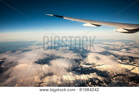 Plane wing over the France Alps