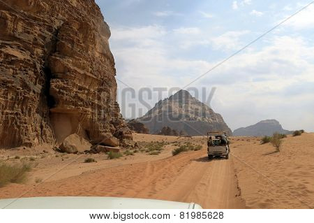 Cars Of Tourists In The Desert Of Jordan