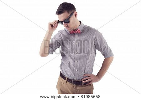 Young man hipster with red bow tie sunglasses shirt short sleeves.