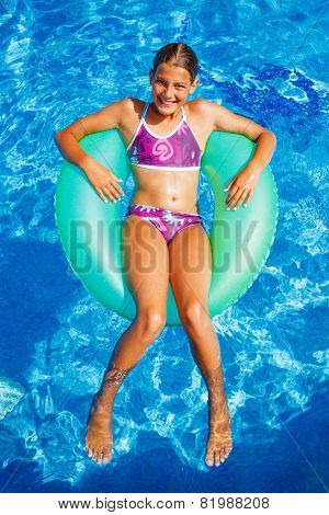 Girl swims in a pool