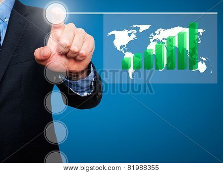 Businessman in dark suit pushing button worldmap global Growth. Green graph on world map.