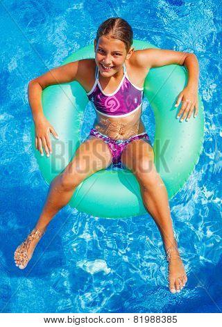 Girl swims in a pool