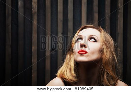 Young Woman Against A Wooden Wall