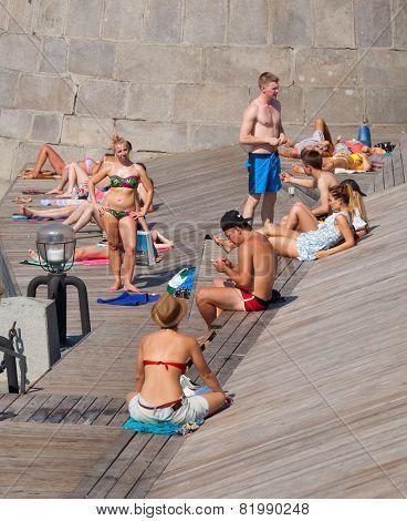 People Sunbathing At Olive Beach
