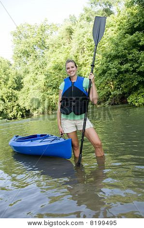 Outdoorsy Female Wearing A Life Jacket With A Kayak