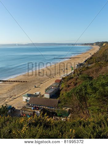 View to the west Bournemouth beach Dorset England UK with blue sky near to Poole