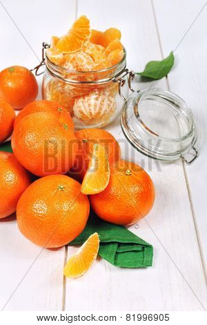 Peeled Tangerines In A Glass Jar