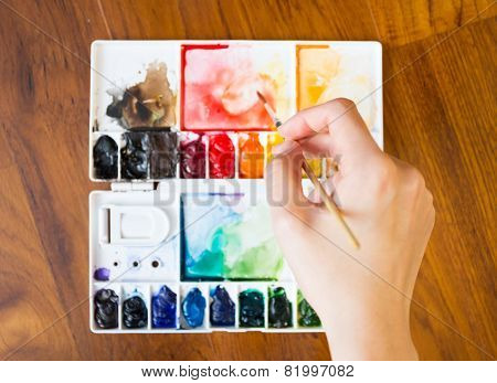 Paintbrush and paint palette