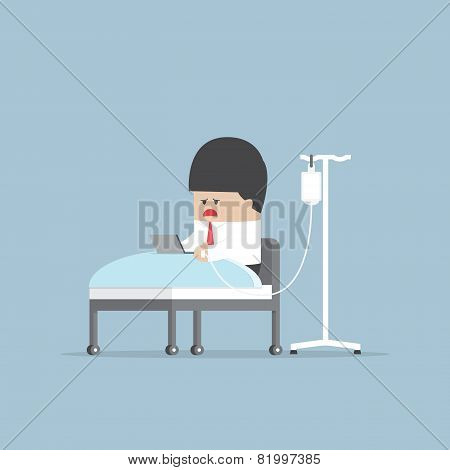 Sick Businessman Working Hard In Hospital Bed