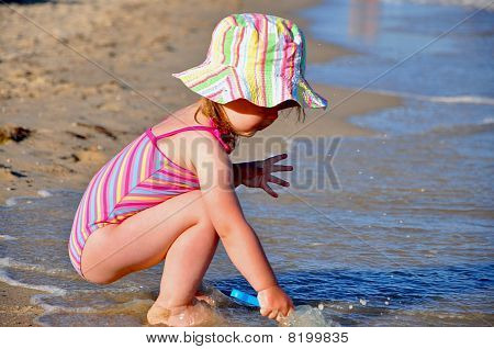 Little cute girl at the seashore