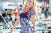 stock photo of flowing hair  - Beautiful blonde with blue eyes and long flowing hair - JPG