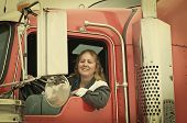 pic of big-rig  - Woman truck driver leaning out the drivers side window - JPG