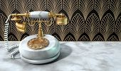 foto of embellish  - A vintage marble and brass telephone with a handset and dial embellishments on a marble shelf on an art deco wallpaper background - JPG