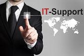 image of backbone  - businessman in black suit pushing button it support international worldmap - JPG