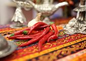 stock photo of chili peppers  - A group of chili pepper on a Turkish traditional cloth - JPG