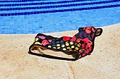 image of nudism  - a swimsuit in a swimming pool in the summer - JPG