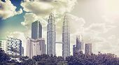 stock photo of klcc  - Retro vintage filtered picture of Kuala Lumpur skyline - JPG