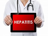 image of hepatitis  - Doctor showing tablet with text hepatitis - JPG