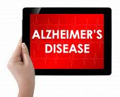 picture of dialysis  - woman showing tablet with text Alzheimers disease - JPG