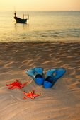 pic of flipper  - Starfish, flippers and boat on sea  sand sunset ** Note: Shallow depth of field - JPG