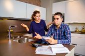 image of unemployed people  - Unemployed young couple with many debts reviewing their bills - JPG