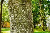 stock photo of headstones  - Gravestone made of headstone with Maltese cross craved in - JPG
