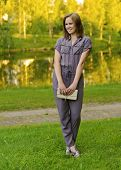 pic of overalls  - Portrait of young woman in stylish overalls outside - JPG