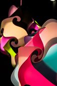 picture of interlocking  - A multicolored background of swirls and interlocking designs - JPG
