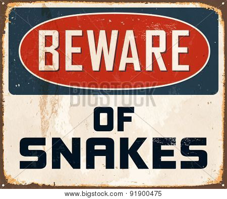 Beware of snakes - Vintage Metal Sign with realistic rust and used effects.