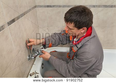 Plumber Works In A Bathroom