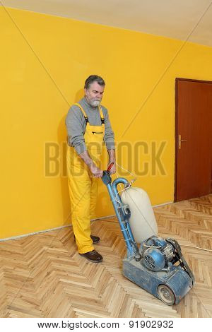 Home Renovation, Worker Sanding Parquet