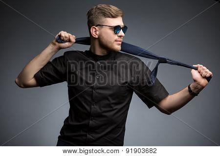 Stylish man in black shirt and mirrored sunglasses