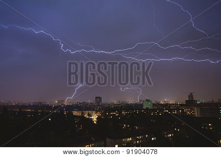 lightning strikes over night town during a thunderstorm. Kiev, U