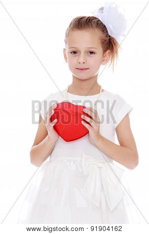 Elegant little girl holding a box