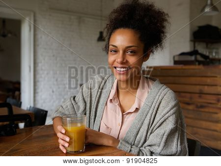 Attractive Smiling Young Woman With Fruit Juice Drink