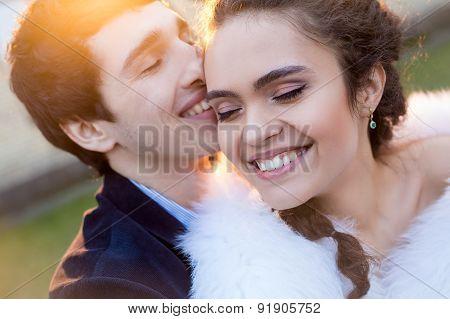 Close portrait of happy wedding couple