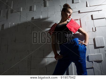 Fashion portrait of a girl in the designer pantsuit