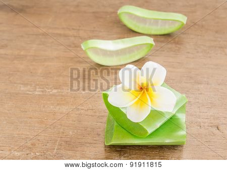 Aloe Vera And Frangipani Flower On Wooden Table
