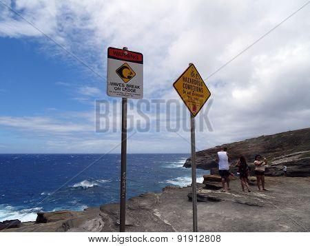 People Take Selfies Photos And Explore Hazardous Area Near Ocean Beyond Signs Warning Of Dangers