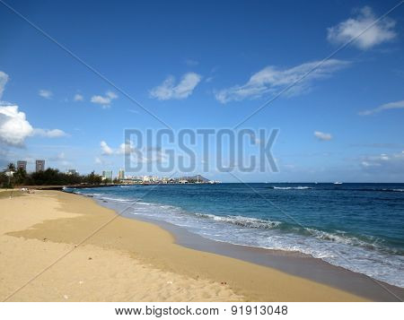 Sand Island Beach With Waves Lapping In The Ocean