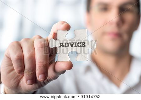 Businessman Holding Puzzle Piece With Advice Text