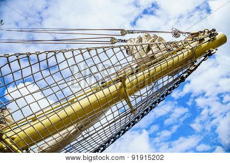 Yachting. Mast Of Sailboat Against Blue Sky.