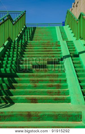 Green Concrete Stairs Stairway With Railing.