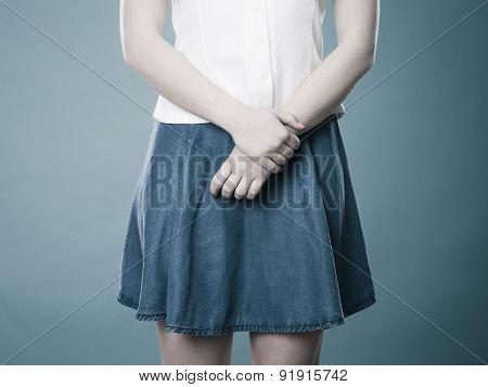 Girl In Blue Denim Skirt
