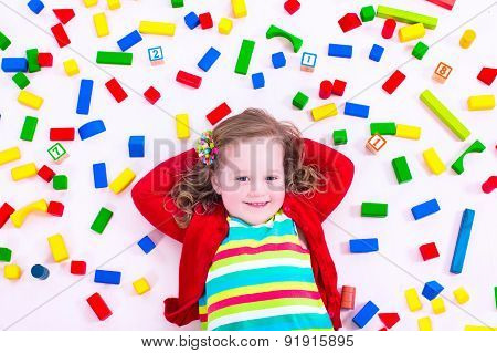 Little Girl Playing With Wooden Blocks