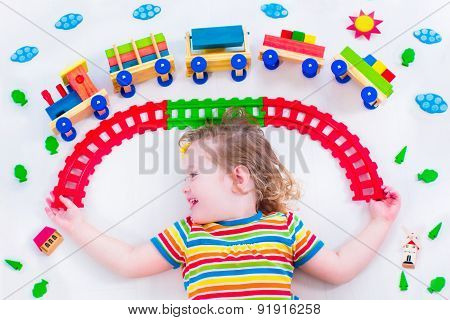 Little Girl With Wooden Train
